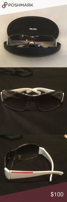 Prada Sunglasses Like new designer sunglasses! Only worn a couple times. No scratches. The tint is a dark gray on the top gradually lightning on the bottom.  These are super cute on! Prada Accessories Glasses