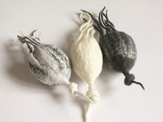 beautiful felt pods - like columbine seed pods or rose hips
