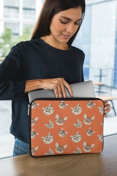 Heading back to school or the office and need a cover to protect your laptop or tablet? Check out these laptop sleeve in our signature orange with a cute cat motif. Made of Neoprene, lined with faux fur to prevent scratching. Comes in two sizes, 13 or 15 in.