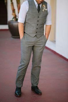 idea for groomsmen-- grey pants and vest, but a white shirt for grooms men an a burgundy one for the groom