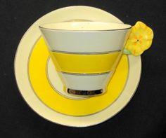 ROYAL PARAGON PLATINUM SILVER YELLOW FLOWER HANDLE TEA CUP AND SAUCER