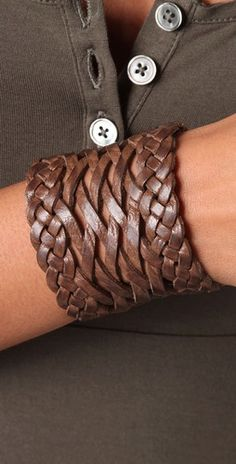 leather cuff=want! i need a couple leather bracelets...