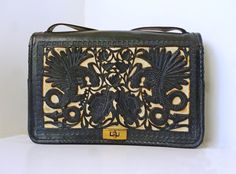 I was definitely born in the incorrect decade.   1930'S-1940'S Tooled Leather Art Deco Mexican Shoulder Bag.