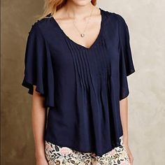 """✨ Anthropologie navy blouse -lightweight woven rayon -pintuck detail -pullover styling -navy color -peek-a-boo button detailing in shoulder (see photo) -very flattering for all body types -27.5""""L -great with high waisted paints, trousers or shorts -can be worn professionally with a blazer or casually with light color denim -excellent condition, no stain, snags, holes Anthropologie Tops Blouses"""
