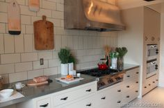 Love the use of drawers, clean lines, and leather pulls