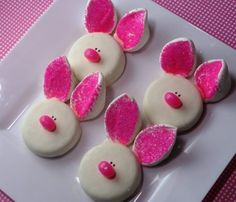 White choc. covered oreos with marshmellow ears. one side dipped into colored sugar