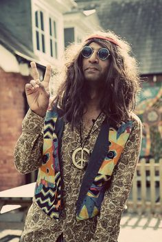 Typical hippie garb included headbands, round lens glasses, colorful patterns, and peace sign jewelry.