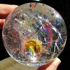 Polished quartz sphere with iron deposit