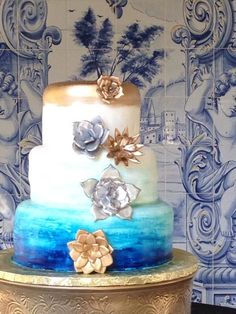 ombre blue and gold wedding cake