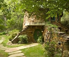 The small stone structure serves as a guest house in Preston Hollow,  a neighborhood in north Dallas,  Texas.     Designed by Stocker Hoesterey Montenegro Architects,  it  was  inspired  by  the  writings  of J.R.R.Tolkien and the 1952 movie,  The Quiet Man,  starring John Wayne and Maureen O'Hara.