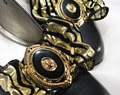 Flashy black and shiny gold repurposed shoe clips