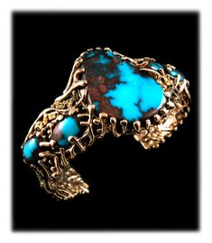 A magnificent Gold, Gold Nugget and Ultra-grade Bisbee Turquoise Bracelet by John Hartman of Durango Colorado