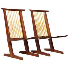 Conoid Lounge Chairs by Mira Nakashima  USA  2003  A pair of walnut conoid lounge chairs with hand-hewn hickory spindles (the seat of one with a butterfly spline spanning a natural cleft). Both chairs are signed on the bottom. Design by George Nakashima, made by Mira Nakashima