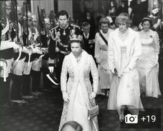 The Queen of England with Charles and Diana