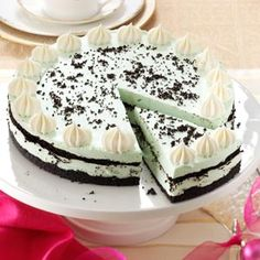 Grasshopper Cheesecake Recipe -What do you get when you combine a popular mint-chocolate drink with a cheesecake? Pure delight! Garnish the top with piped whipped cream and cookie crumbs. —Marie Rizzio, Interlochen, Michigan