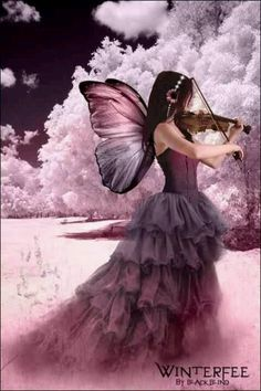 This is Molly she is a music fairy she is especially good at violin