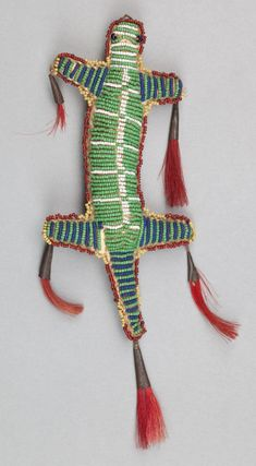 A SIOUX BEADED HIDE FETISH. c. 1890. These were typically hung from a baby's cradle board & when the remaining piece of umbilical cord dried up and fell off the infant's naval, the umbilical cord was concealed inside. The child would keep the fetish for the rest of their lives as a symbolic & sacred connection to their mother (as the umbilical cord literally connected the two together as one).