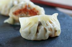 Potstickers are Chinese dumplings with ground meat, veggie, pan-fried and then steamed. Easy and the BEST potstickers recipe you can make at home.