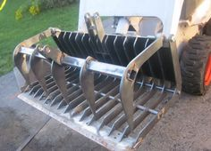 Grapple Bucket by SkidRoe -- Homemade grapple bucket fabricated from CNC-cut steel and featuring a leading edge blade adapted from a Zamboni unit. http://www.homemadetools.net/homemade-grapple-bucket