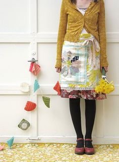 I love to wear this stuff and make my own aprons out of vintage linens! and cardigans are my favorite!