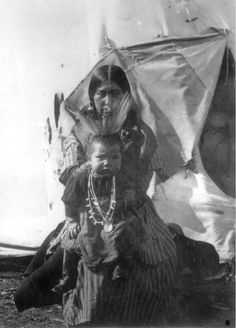 View of a Native American Flathead (Salish) woman, identified as Mrs. Loma, and her infant child - Stone - 1907