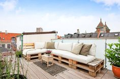 Modern zen rooftop terrace using upcycled pallets for seating. Image: Andreas Ravn