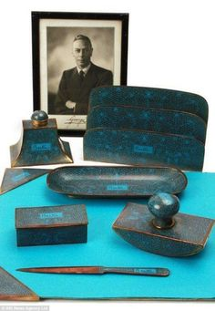The turquoise gilt set was given to King George VI by his brother the Duke of Windsor, shortly after he abdicated in 1936 to marry divorcee Wallis Simpson.    The set includes a letter rack, an ink well, roller blotter, pen tray, paper knife,and stamp box, each with the the king¿s nickname, Bertie, engraved on it.