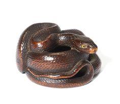 A wood netsuke of a snake By Kokei, early 19th century