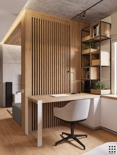 vertical slat wall in natural wood finish separates the space for a home office