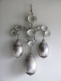 T i m o t h y  H o r n Pearl Works mirrored blown glass, nickel-plated bronze, cast lead crystal