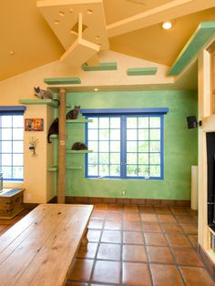 A peaceful place to get away from it all; this four bedroom, two and a half bathroom home has been transformed into an oasis full of life.Plants, animals, playful colors, and every electronic