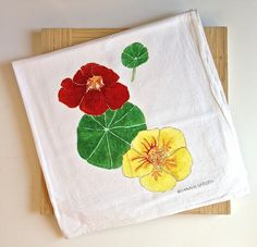 Nasturtium Flour Sack Tea Towel. Screen print of a watercolor painting. Nasturtiums are so summery and aside from being charming in the garden, they're so delicious in salads. Sweet tea towel that captures the nasturtium freshness.