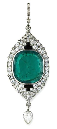 A RARE INDIAN INFLUENCED ART DECO EMERALD AND DIAMOND PENDANT, BY CARTIER The cushion-shaped emerald to the circular-cut diamond-set plaque with onyx detail suspending a pear-shaped diamond drop, French, 1921, 8.6 cm long, in fitted black leather case Signed Cartier