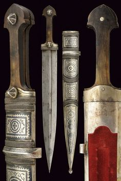 Circassian / Caucasian kindjal dagger,  last quarter of the 19th Century. Straight, double-edged blade with asymmetrical grooves; grip with horn grip scales and nielloed, silver mounts; silver-plated, wooden scabbard decorated with nielloed floral motifs and beaded bands, dimensions: length 47.3 cm.