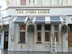 Here at the Young's pub, The Three Lords in London, we installed 2 bespoke awnings on the pub's exterior. No one has awnings that look quite like this!