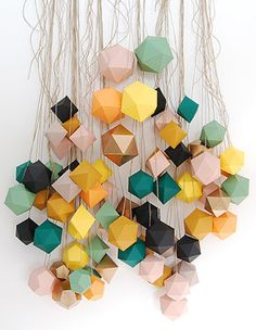 paper mobile made from metallic gold paper cubes