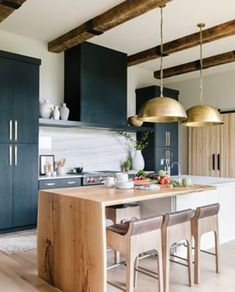 modern kitchen design with navy cabinets and rustic wood kitchen island with modern barstools and gold kitchen pendant lights, rustic ceiling beams in modern farmhouse kitchen with blue cabinets, neutral rustic kitchen design Home Interior, Interior Design Kitchen, Interior Livingroom, Kitchen Designs, New Kitchen, Kitchen Decor, Kitchen Ideas, Kitchen Inspiration, Gold Kitchen