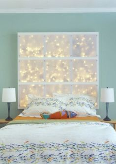 Easy DIY: Using sheer cloth on a simple wood frame with string lights in the background make a very iconic head board!
