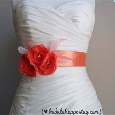 "Coral and Blush Flower Bridal Sash, Accessories Three sweet coral chiffon flowers mounted on a 2"" super soft coral ribbon sash.  Accented with blush and coral feather accents and clusters of pearl/seed bead centers. Message me about custom colors.  You will receive the exact sash in the photos.  *Note it measures 2 yards (6feet) in total length.*  Original Design and Copyright 2010-2015. All design and photo rights belong to Bridal Shoppe. Bridalshoppe Accessories"