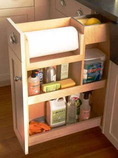 """Top-Down Organization  """"Stock a kitchen pullout drawer based on supplies you'll need most while cleaning. Position often-used towels, scrubbers, and cleaning agents on higher shelves for easy access. Stash seldom-used items lower to keep them within reach but out of the way."""""""