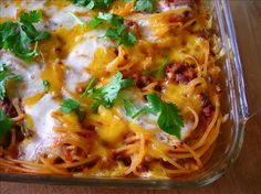 Southwestern Baked Spaghetti. (uses ground beef, onion, green pepper, garlic, chili pwdr, cumin, oregano, tomato sauce, cheddar, MontereyJack cheese)