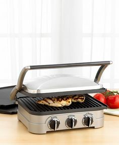 Cusinart Griddler.  Absolutely love it!! Opens flat for pancakes or eggs, have made Panini, GrilledBurgers, Qusadillas and I just ordered the waffle plates. All this and no fuss clean up.