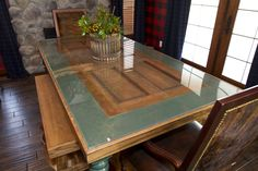 Awesome table made out of a repurposed door in a Casual Lodge style dining room on Extreme Makeover