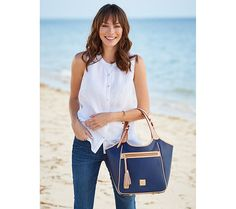 Style and substance. With Dooney & Bourke's Maddie leather shoulder bag, you won't have to leave anything behind. Page 1 QVC.com