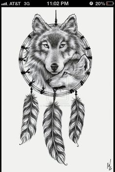 thigh tattoo or could be a calf tattoo. love how its wolves in a dream catcher :)...