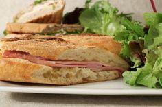 A ham sandwich with crusty bread.