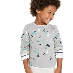 From the classroom to the playground, he's warm and cozy in this graphic French terry pullover.