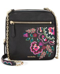 """Vibrant embroidery adds signature whimsy to a compact Vera Bradley crossbody hung from bright chain-links and secured with a gilded zip. 