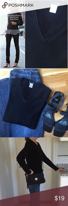 """J Crew Black Sweater J Crew black V Neck sweater on right of cover photo.  An example outfit fromGlam Radar on left in cover photo. Basic black JCrew sweater goes  with so many items in a closet. Merino wool.  Bracelet sleeves.  24"""" from shoulder to bottom of sweater.  Good condition. J. Crew Sweaters V-Necks"""