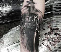 Violin tattoo by Steve Butcher